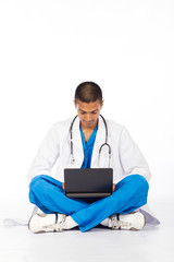 young male indian medical resident using laptop