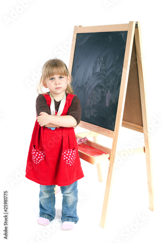standing near blackboard angry preschool girl