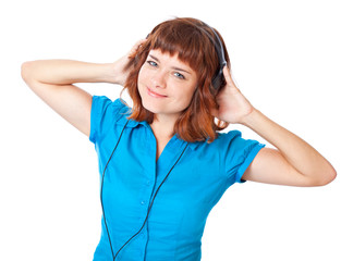 Young red-haired girl listen to music and dance
