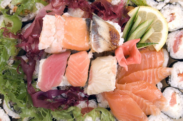 Composition of rolls, fish and vegetables