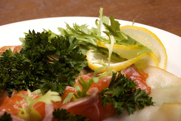 Appetizer made of meat and fish served with salad