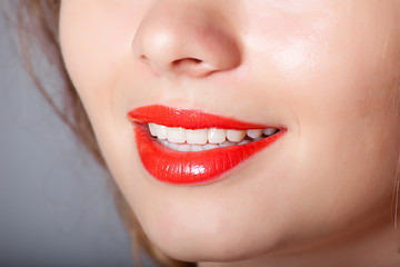 Red lips in a beautiful smile