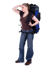standing young female tourist with backpack, isolated