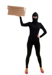 thief in black clothes and balaclava with boxes