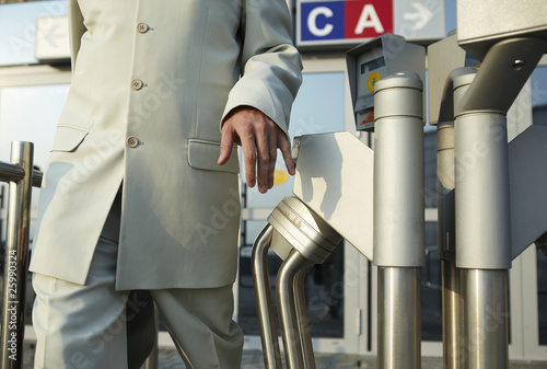 businessman standing at the security gate
