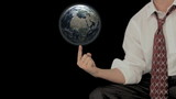 Man Spinning Globe on Finger