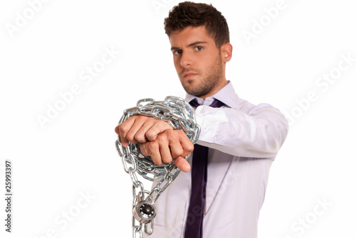 Businessman chained with padlock, job slave symbol, isolated