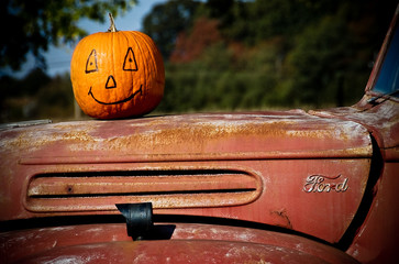 pumpkin on old ford pick up truck