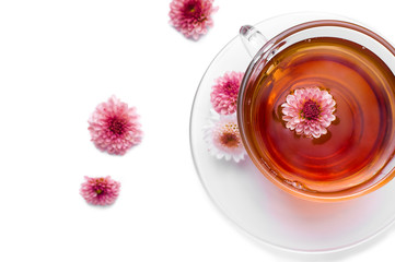 cup of herbal tea with pink flowers