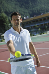young man play tennis outdoor