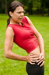 Buttocks injury - sportswoman in pain