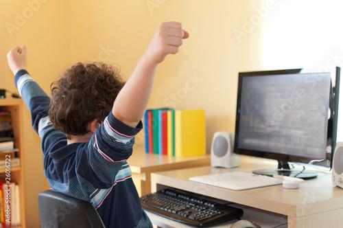 Boy using computer at home - 26016722