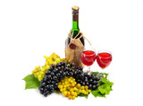 Arrangement of grapes with a bottle of wine and glasses