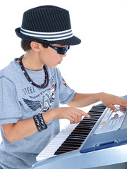 child playing musical keyboard isolated on white background