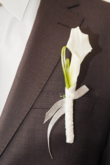 Groom with flower on the wedding day