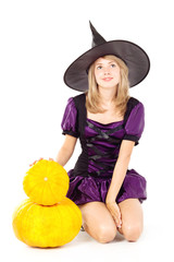 blonde witch sitting on a pumpkin, holding a pumpkin