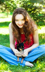 gay teen girl with a small dog in the hands
