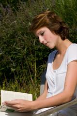 Cute girls reading a book