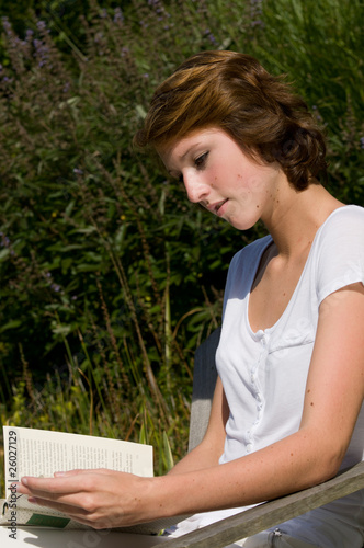 Cute girls reading a book