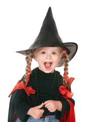 Child witch in black costume. Isolated.
