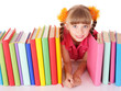 Child holding pile of colored  book.