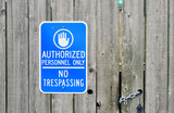 Authorized Personnel Only sign on a chained old wooden fence. poster