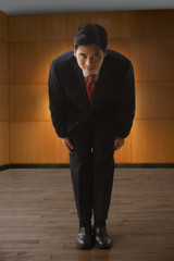 Chinese businessman bowing in greeting