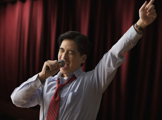 Chinese businessman singing karaoke