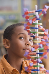African boy studying dna model
