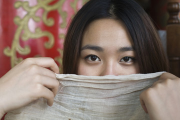 Chinese woman hiding behind scarf
