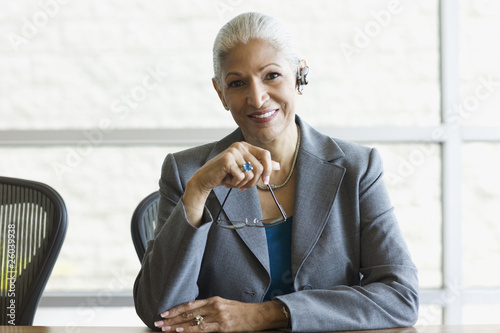 African businesswoman with eyeglasses and earpiece