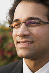 Close up of Indian businessman in eyeglasses