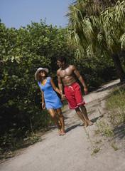 Couple walking along remote tropical path