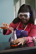 African teenage girl performing experiment in chemistry lab