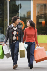 Couple carrying shopping bags