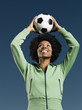 African woman holding soccer ball