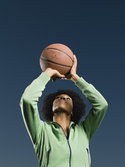 African woman playing basketball