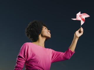 African woman looking at pinwheel