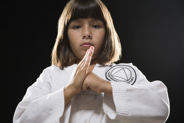 Hispanic girl posing in karate uniform
