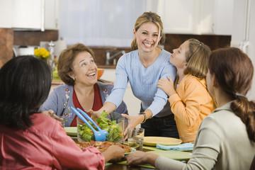 Hispanic family eating in kitchen