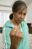 Angry senior African woman making a fist