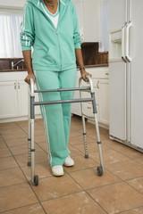 Senior African woman walking with walker