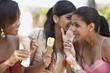 Teenage friends sharing secrets