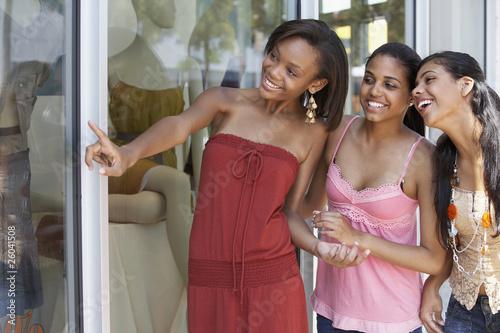 Teenage friends window shopping