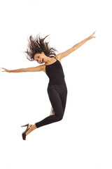 Cute young energetic girl wearing black jumping in air