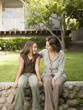 Hispanic mother and daughter smiling at each other