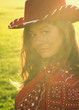 Woman wearing cowboy hat in sunlight