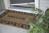 Open door and Welcome doormat