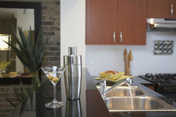 Martini and shaker on counter in kitchen