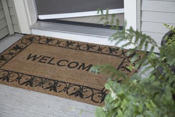 Open door and Welcome doormat